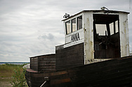 Hiiumaa, Estonia - July 18, 2015: In Sõru, on the south coast of the Estonian island of Hiiumaa, a wooden boat named Anna sits propped up on land not far from the Baltic Sea.