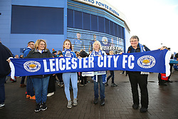 Leicester City fans showing their support by hold a scarf outside the King Power Stadium