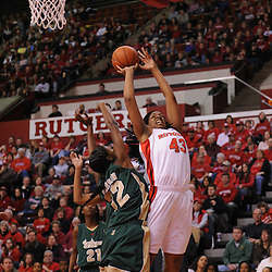 Jan 31, 2009; Piscataway, NJ, USA; Rutgers center Rashidat Junaid (43) puts up a shot against South Florida center Brittany Denson (32) during the first half of South Florida's 59-56 victory over Rutgers in NCAA women's college basketball at the Louis Brown Athletic Center