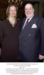 The HON.NICHOLAS & MRS SOAMES at a party in London on 29th April 2002.<br />OZL 158