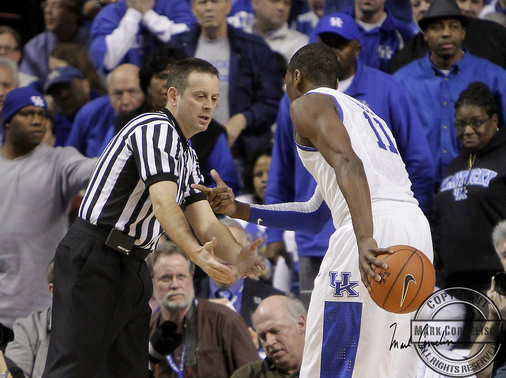 Kentucky guard John Wall  pleaded his case with official Doug Sirmons after Sirmons called a foul on him as Kentucky defeated South Carolina 82-61  on Thursday February 25,  2010 in Lexington , Ky. Photo by Mark Cornelison oe Staff.