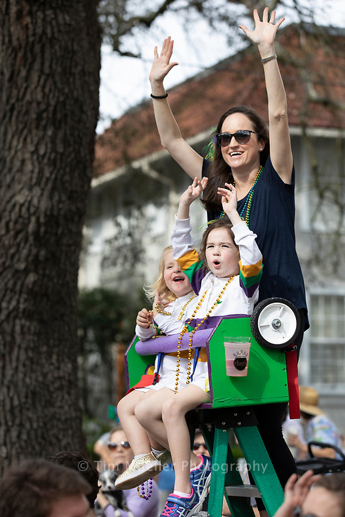 Libby Zoghby, top center, shouts for beads with the help of, from left, Alice Granade, 3, and Jane Zoghby, 6. The Krewe of Freret parades through uptown New Orleans. The Krewe paraded for more than 40 years until the mid-1990s. In 2011, they reorganized and created a unique parade favoring local vendors and craftspeople. Members also hand-decorate Mardi Gras Masks as coveted signature throws.