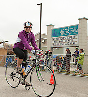 """Devitt Liptak heads out onto the 15 mile bike course around Paugus Bay for the """"Take the Bay Challenge"""" during Saturday's WOW Fest event at Laconia Athletic and Swim Club.  (Karen Bobotas/for the Laconia Daily Sun)"""