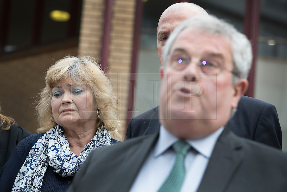"""© Licensed to London News Pictures. 03/06/2016. Woking, UK.  Doreen James listens as her husband Des James speaks to reporters as they leave Woking Coroner's Court. A second inquest into the death of army recruit Private Cheryl James has announced its verdict today. Coroner Brian Barker QC has ruled the death of Private James was caused by a """"self-inflicted"""" wound. Cheryl was found dead with a bullet wound to her head in November 1995.  Aged just 18 she was one of four young soldiers who died at the Deepcut Barracks in Surrey between 1995 and 2002, amid claims of bullying and abuse. Photo credit: Peter Macdiarmid/LNP"""