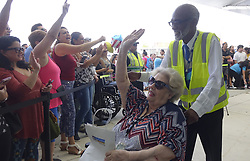 October 3, 2017 - Fort Lauderdale, FL, USA - A Caribbean hurricane evacuee who arrived on board the Royal Caribbean Adventure of the Seas, react tot he waiting crowd, Tuesday, Oct. 3, 2017, at Port Everglades in Fprt Lauderdale. More than 3,000 people from Puerto Rico and the U.S. Virgin Islands were brought to Florida on board the Royal Caribbean Adventure of the Seas, Tuesday, Oct. 3, 2017, at Port Everglades in Fort Lauderdale. (Credit Image: © Joe Cavaretta/TNS via ZUMA Wire)