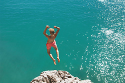 Teenager water cliff sunshine summer holiday jump