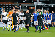 The match officials lead on both sides during The FA Cup 3rd round match between Fulham and Oldham Athletic at Craven Cottage, London, England on 6 January 2019.