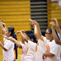 """0606613  Adron Gardner/Independent<br /> <br /> Young basketball campers show their """"goose neck"""" shooting form during the girls and boys basketball camp at Gallup High School in Gallup Thursday."""