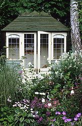 Summerhouse framed by summer borders
