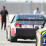 Sprint Cup Series driver Dale Earnhardt Jr. (88) drives his National Guard car from the garage area at Daytona International Speedway on February 18, 2011 in Daytona Beach, Florida. (AP Photo/Alex Menendez)
