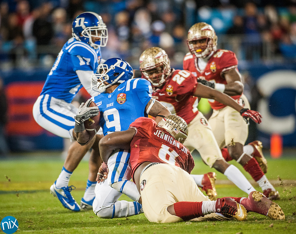 Florida State's Timmy Jernigan takes down Duke running back Josh Snead during the ACC Championship game at Bank of America Stadium in Charlotte Saturday night. Florida State won the game 45-7.