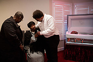 Isaiah Jenkins tries to comfort his grandmother Betty Jo Jenkins, at her husband, Billy Joe Jenkins, funeral in<br /> Cleveland, GA.