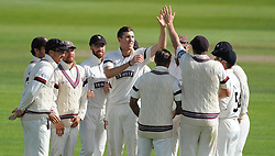 Somerset's Craig Overton celebrates the wicket of Hampshire's James Vince with his teammates.  - Mandatory byline: Alex Davidson/JMP - 07966386802 - 12/09/2015 - CRICKET - The County Ground -Taunton,England - Somerset CCC v Hampshire CCC - Day 4