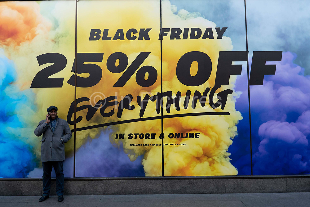 Shoppers outside Topshop Topman chain store on London's Oxford Street for the Black Friday on the 29th November 2019 in central London in the United Kingdom. Black Friday is a shopping event that originated from the US where retailers cut prices on the day after the Thanksgiving holiday.