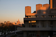 Autumn scene with sun setting on the National Theatre on the Southbank riverside walkway, London, United Kingdom. The South Bank is a significant arts and entertainment district, and home to an endless list of activities for Londoners, visitors and tourists alike.