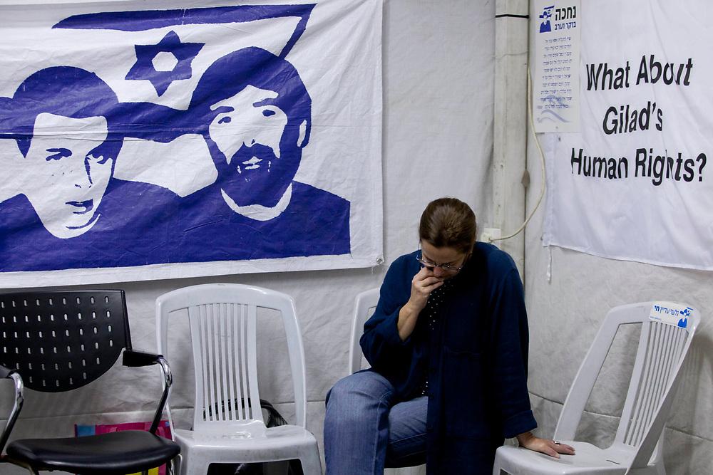 Aviva Shalit, mother of Israeli captured soldier Gilad Shalit, sits inside a protest tent outside Prime Minister Netanyahu's residence in Jerusalem on November 29, 2010, as she awaits the arrival of Germany's President.