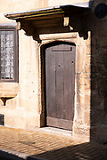 Old timber front door on the High Street in popular tourist town Chipping Campden in The Cotswolds, Oxfordshire, UK