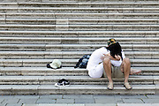 couple sitting on marble stairs in Venice Italy