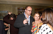 Alex Proud, Sean Ellis and Tagheuer host party to launch the photo book, 365: Ayear in fashion, Claridge's Bar. 20 May 2003. © Copyright Photograph by Dafydd Jones 66 Stockwell Park Rd. London SW9 0DA Tel 020 7733 0108 www.dafjones.com