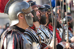 Trafalgar Square, London, March 25th 2016. Thousands of Londoners an tourists in Trafalgar Square are treated to The Passion of Jesus, a re-enactment of the events leading up to the crucifixion and resurrection of Jesus Christ. PICTURED: Roman soldiers look on as Jesus is tried. <br /> ©Paul Davey<br /> FOR LICENCING CONTACT: Paul Davey +44 (0) 7966 016 296 paul@pauldaveycreative.co.uk