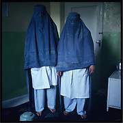 Two nurses pose for a photograph with their burqa on in Badakshan.