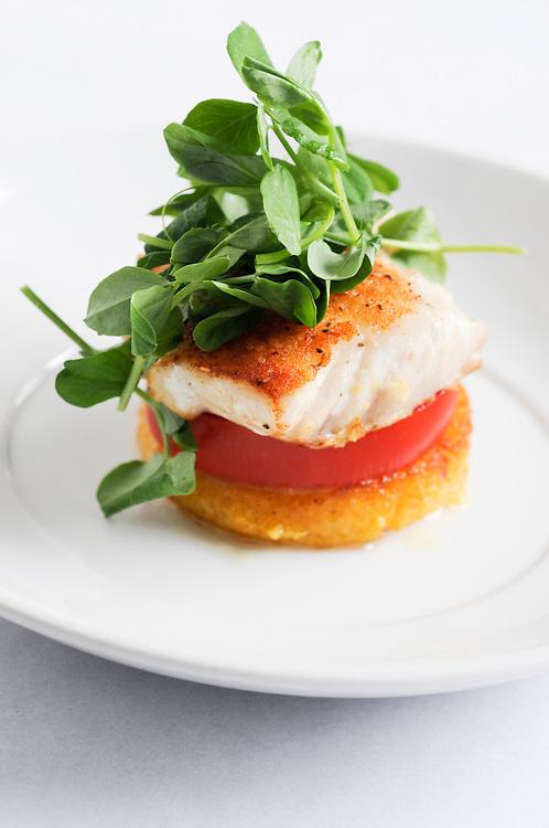 Seared halibut with local tomatoes, crisp polenta and pea shoots.
