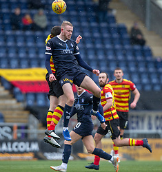 Falkirk's Zak Rubben tackled by Partick Thistle's Steven Saunders. Falkirk 1 v 1 Partick Thistle, Scottish Championship game played 16/3/2019 at The Falkirk Stadium.