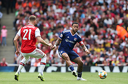 Memphis Depay of Lyon  passes the ball under pressure - Mandatory by-line: Arron Gent/JMP - 28/07/2019 - FOOTBALL - Emirates Stadium - London, England - Arsenal v Olympique Lyonnais - Emirates Cup