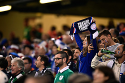 A France supporter in the crowd holds up a scarf in support - Mandatory byline: Patrick Khachfe/JMP - 07966 386802 - 11/10/2015 - RUGBY UNION - Millennium Stadium - Cardiff, Wales - France v Ireland - Rugby World Cup 2015 Pool D.