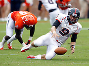 Richmond Spiders quarterback John Laub (9) recovers a fumble in front of Virginia Cavaliers linebacker LaRoy Reynolds (9) during the first half of the NCAA football game Saturday September, 1, 2012 at Scott Stadium in Charlottesville, Va.