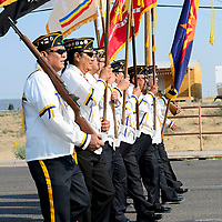 Members of the Ira H. Hayes Post 84 Color Guard carry the colors down HW 264 for the Navajo Code Talkers Parade in Window Rock, AZ on Aug. 14, 2018.