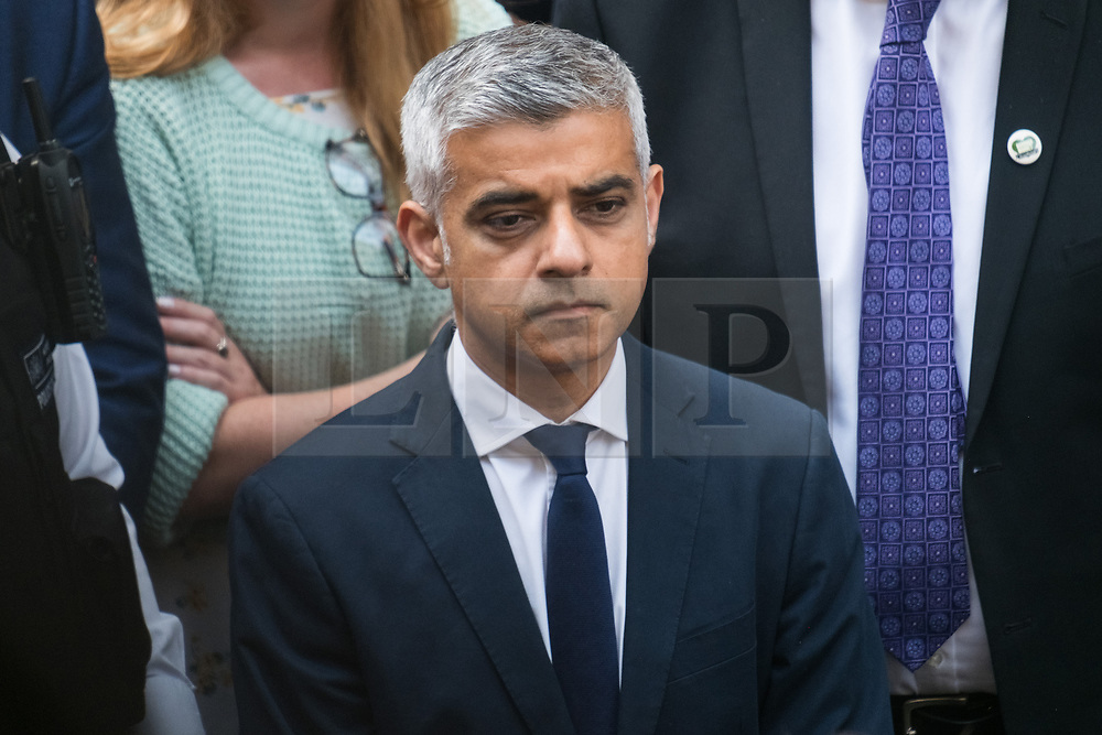 © Licensed to London News Pictures. 14/06/2017. London, UK. London Mayor SADIQ KHAN observes a minutes silence shop owners and stall holders as Borough Market re-open on the first day of trading after the terrorist attacks 3rd June which left eight people dead and three terrorists shot dead by police. Photo credit: Ray Tang/LNP