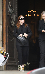 Julianne Moore leaving the funeral service for late photographer Peter Lindbergh held at Saint Sulpice church in Paris, France on September 24, 2019. Photo by ABACAPRESS.COM