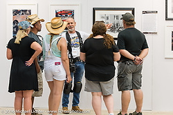 Michael Lichter talking with visitors at his display of Limited Edition prints at the 2016 ROT (Republic of Texas Rally). Austin, TX, USA. June 11, 2016.  Photography ©2016 Garrett Stanley.