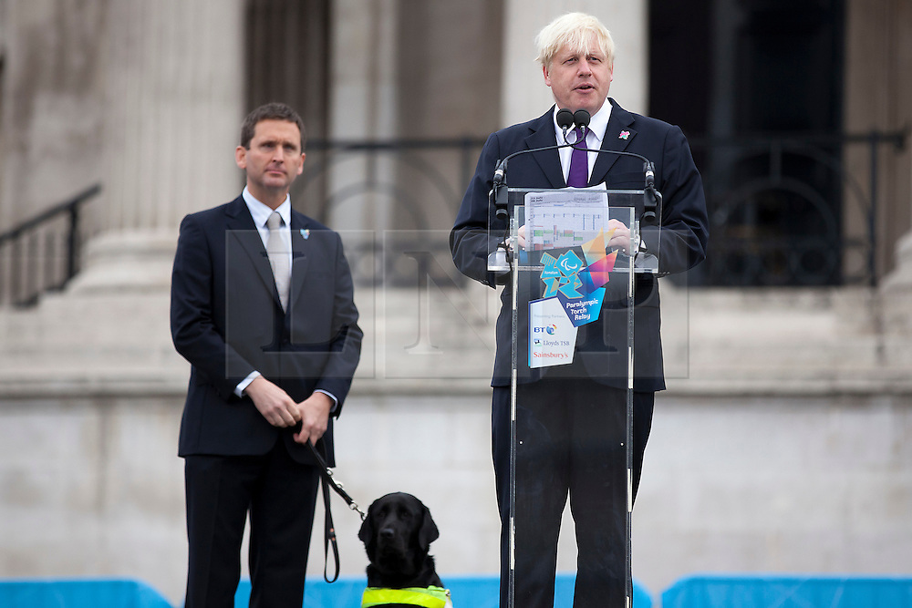 © Licensed to London News Pictures. 24/08/2012. LONDON, UK. Boris Johnson, the Mayor of London (R), gives a speech about the London 2012 Paralympic Games after being introduced by former Paralympic athlete, and now Director of Paralympic Integration, Chris Holmes during the lighting of a Paralympic Cauldron in Trafalgar Square. Photo credit: Matt Cetti-Roberts/LNP