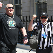 One hundred very friendly Newcastle United fans protest against the premier league being TransparencyForFans the NUFCTakeover in Parliament Square, on 16th July 2021, London, UK.