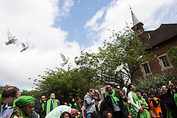 London, UK. 14th June, 2018. Family members release doves of peace outside St Helen's Church to mark the first anniversary of the Grenfell Tower Fire.