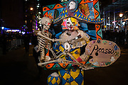 New York, NY - 31 October 2016. A parade goer costumed as a painting of a harlequin carrying a skeleton  by Pablo Picasso in the Greenwich Village Halloween Parade.
