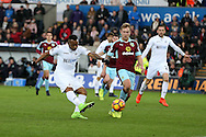 Jordan Ayew of Swansea city has a shot at goal. Premier league match, Swansea city v Burnley at the Liberty Stadium in Swansea, South Wales on Saturday 4th March 2017.<br /> pic by Andrew Orchard, Andrew Orchard sports photography.