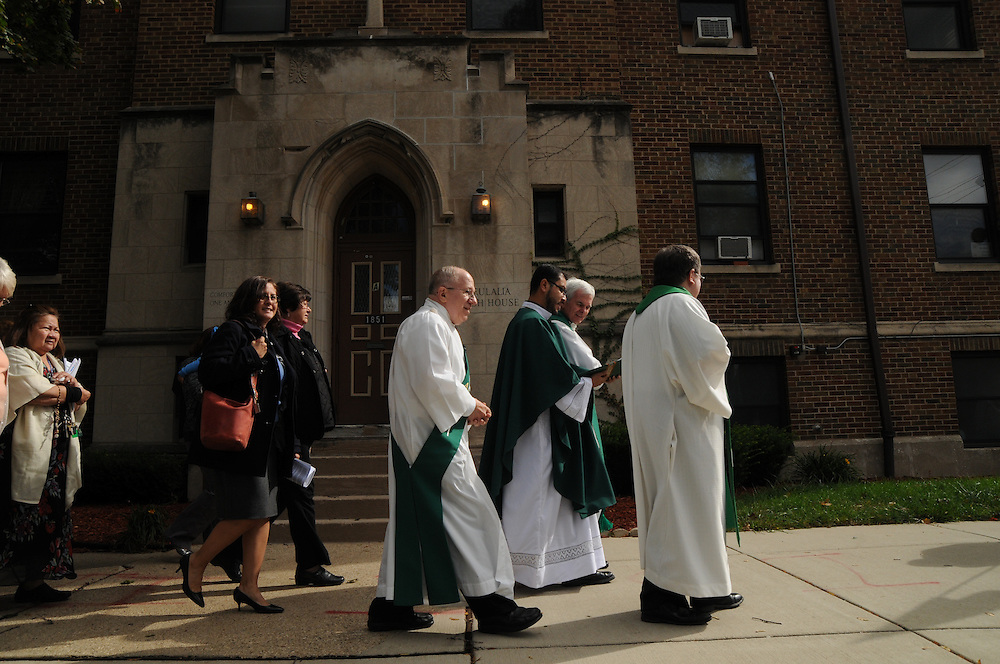 Parishioners at St. Eulalia Catholic Church in Maywood process around the block from the church to inaugurate the Quinn Community Center, a recent project that the church took on to upgrade it's underutilized former parish school into a vibrant building for the neighboring communities of Maywood and Broadview. The project to revitalize the building was undertaken by Pastor Carmelo Mendez, naming the center for former St. Eulalia Pastor William Quinn. Quinn made a lasting history for himself as a pioneer for social justice, both in the fields of civil rights, along with those of immigrants in the U.S. He died in 2004.