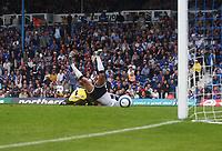 Photo: Alan Crowhurst.<br /> Portsmouth v Tottenham Hotspur. Barclaycard Premiership.<br /> 13/08/2005. Mido scores the opener for Spurs just as keeper Sander Westerveld upends him.