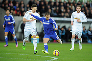 Eden Hazard of Chelsea has a shot at goal. Barclays Premier League match, Swansea city v Chelsea at the Liberty Stadium in Swansea, South Wales on Saturday 17th Jan 2015.<br /> pic by Andrew Orchard, Andrew Orchard sports photography.
