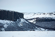 Typical dramatic Icelandic landscape of snow covered mountains of volcanic rock in winter in South Iceland
