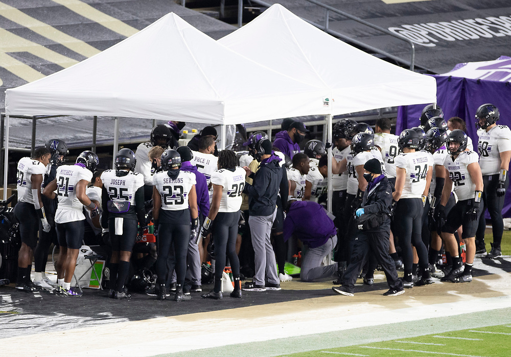 November 14, 2020:  Northwestern players gather under the tents during NCAA football game action between the Northwestern Wildcats and the Purdue Boilermakers at Ross-Ade Stadium in West Lafayette, Indiana. Northwestern defeated Purdue 27-20.  John Mersits/CSM.