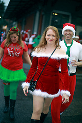 14 December 2013. New Orleans, Louisiana. <br /> The 3rd annual running of the Santas in downtown New Orleans. Proceeds from the event benefit 'That Others May Love' charity.<br /> Photo; Charlie Varley/varleypix.com