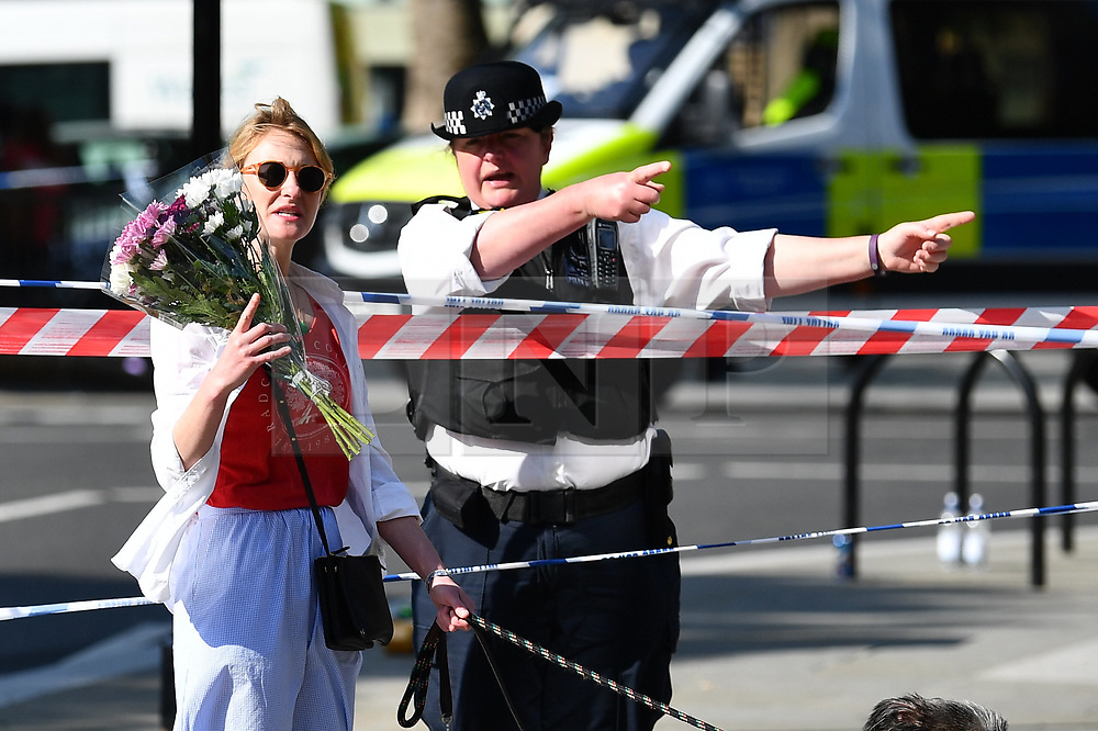 © Licensed to London News Pictures. 15/06/2017. London, UK. Flowers being left at The scene the day after the a huge fire at a Grenfell tower block in west London. The blaze engulfed the 27-storey building with hundreds of firefighters attending the scene. Photo credit: London News Pictures