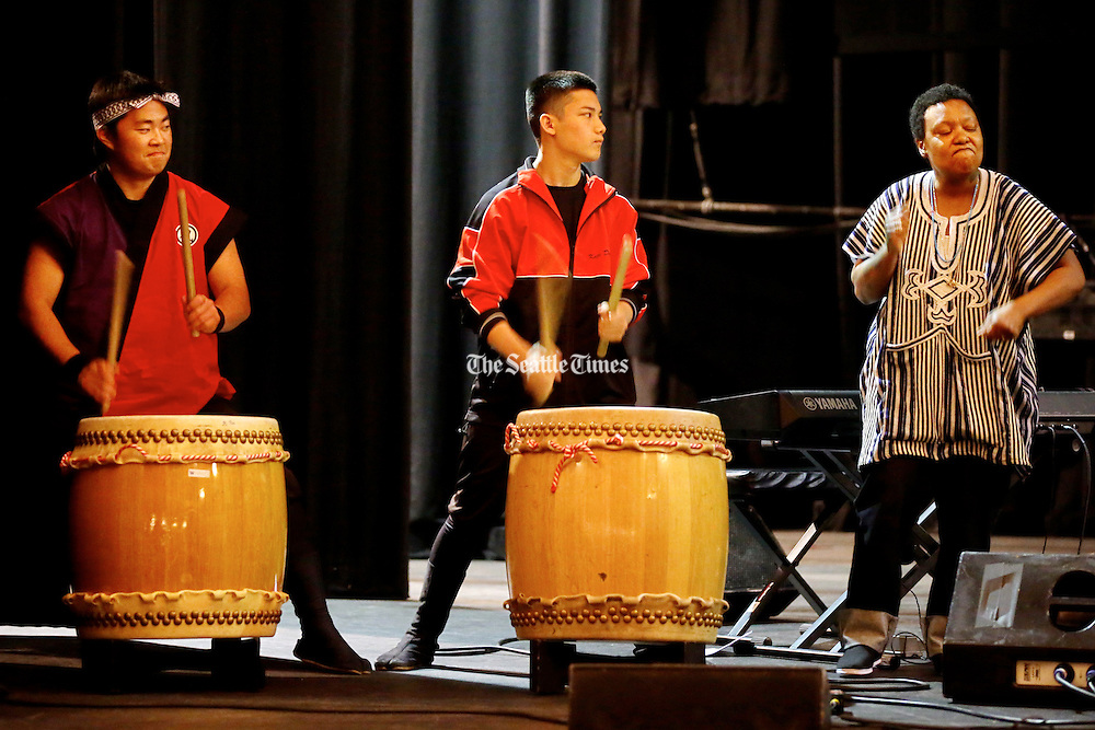 Japanese Taiko Drummers Bryce Bergano, left and Koji Sato of Kaze Daiko accompany a vocal piece by music director Meshell Ndegeocello, right, during a rehearsal for More Music @ The Moore. <br /> <br /> Sunday May 5, 2013 at The Moore Theatre in downtown Seattle. <br /> <br /> Bettina Hansen / The Seattle Times