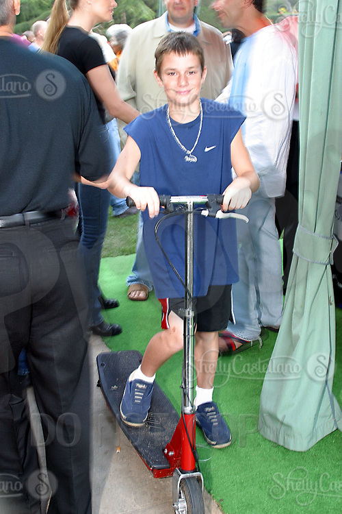Jul 09, 2002; Los Angeles, CA, USA; HUGH HEFNER's 10year old son COOPER HEFNER rides around his back yard guests on an electric scooter as SUGAR RAY LEONARD BOXING first year anniversary was celebrated with a live fight night on ESPN2 from the Playboy Mansion in Holmby Hills.  Over 350 invited guests attended the cocktail reception and showdown in the back yard of Playboy HUGH HEFNER's 5 1/2 acre estate. <br /> Mandatory Credit: Photo by Shelly Castellano/ZUMA Press.<br /> (©) Copyright 2002 by Shelly Castellano