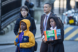 """© Licensed to London News Pictures. 29/11/2016. London, UK. Yilak Andargachew, Menabe Andargachew, Clive Lewis MP and Dame Harriet Walter bring a petition to Downing Street calling on the Prime Minister to seek the release of British man Andargachew """"Andy"""" Tsege, who is in his sixties, who is in prison in Ethiopia under the shadow of a death sentence. Andargachew Tsegehas been detained in the country since he was removed from an airport in Yemen in June 2014. The father-of-three, who fled the country in the 1970s and sought asylum in the UK in 1979, had been a prominent critic of Ethiopia's ruling party. Photo credit : Tom Nicholson/LNP"""