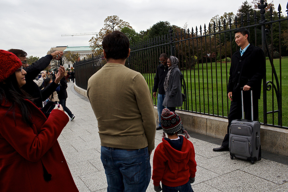 Families and tourists take photographs in front of the White House on Nov. 7, 2012, the day after President Barack Obama was declared the winner of the 2012 Presidential Election.